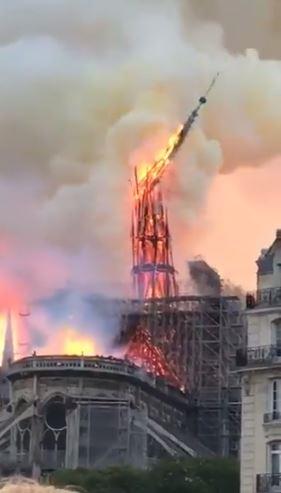 notre-dame-burning-spire-falling